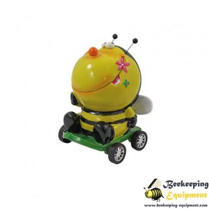 Money box bee in wheelbarrow
